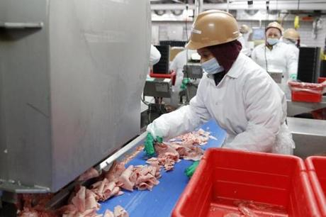 A worker sorted shaved beef at the plant in Lynn.